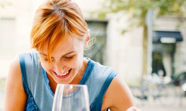 Woman having dinner with wine